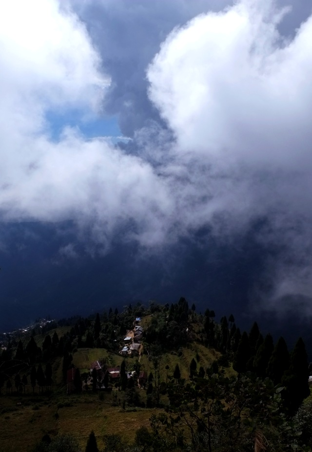 large cloud over tiny village
